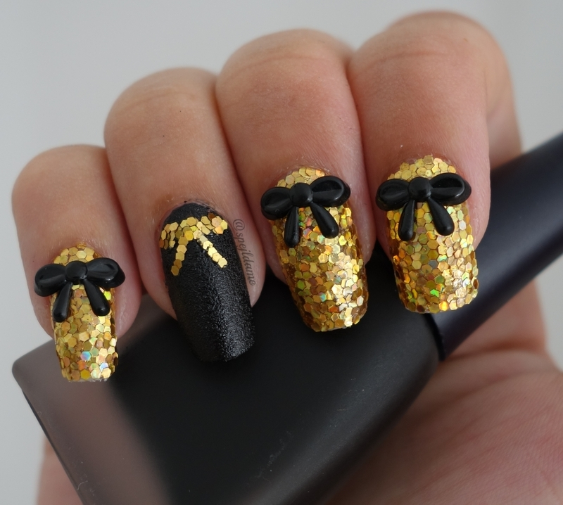 Ember Black And Gold Bow Nail Art
